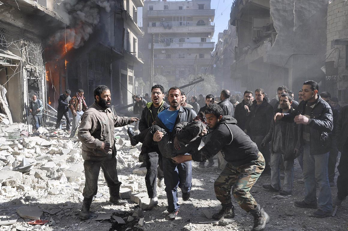 ATTENTION EDITORS - VISUAL COVERAGE OF SCENES OF INJURY OR DEATH Residents rescue a man after what activists said was shelling from forces loyal to Syria's President Bashar Al-Assad in Aleppo's Bustan al-Qasr neighbourhood, February 8, 2014. REUTERS/Yaman Al Halabi (SYRIA - Tags: POLITICS CIVIL UNREST CONFLICT) TEMPLATE OUT NYTCREDIT: Yaman Al Halabi/Reuters